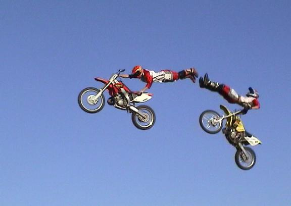 Cody Elkins and Johnny Jones touch on a superman seat grab and a bar hop - Both FMX Tricks are outlined in the FMX School.