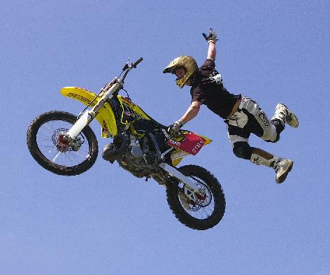 Jason Rowe hanging off his FMX bike.